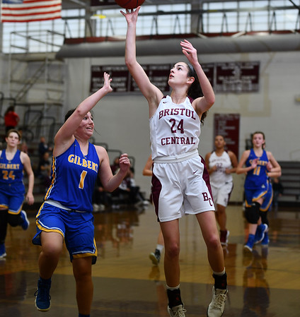 12/31/2019 MIke Orazzi | StaffrBristol Central's Sophia Torreso (24) and GIlbert's Abbey Beecher (1) during Tuesday's girls basketball game at Bristol Central in Bristol.