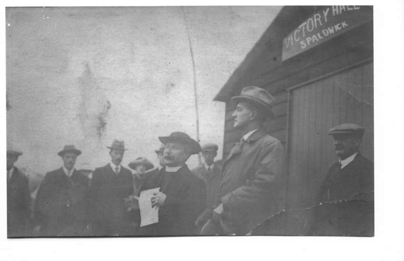 Commander Locker-Lampson, M.P. about to open the Victory Hall in Spaldwick, the Rev Peter Miller explaining how the scheme came about. December 1921 Photo provided by E.A. Adams