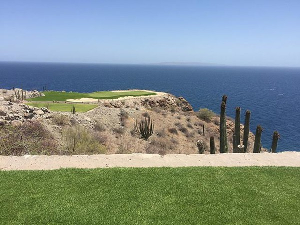 Golf course with the blue Sea of Cortez waters in the background.