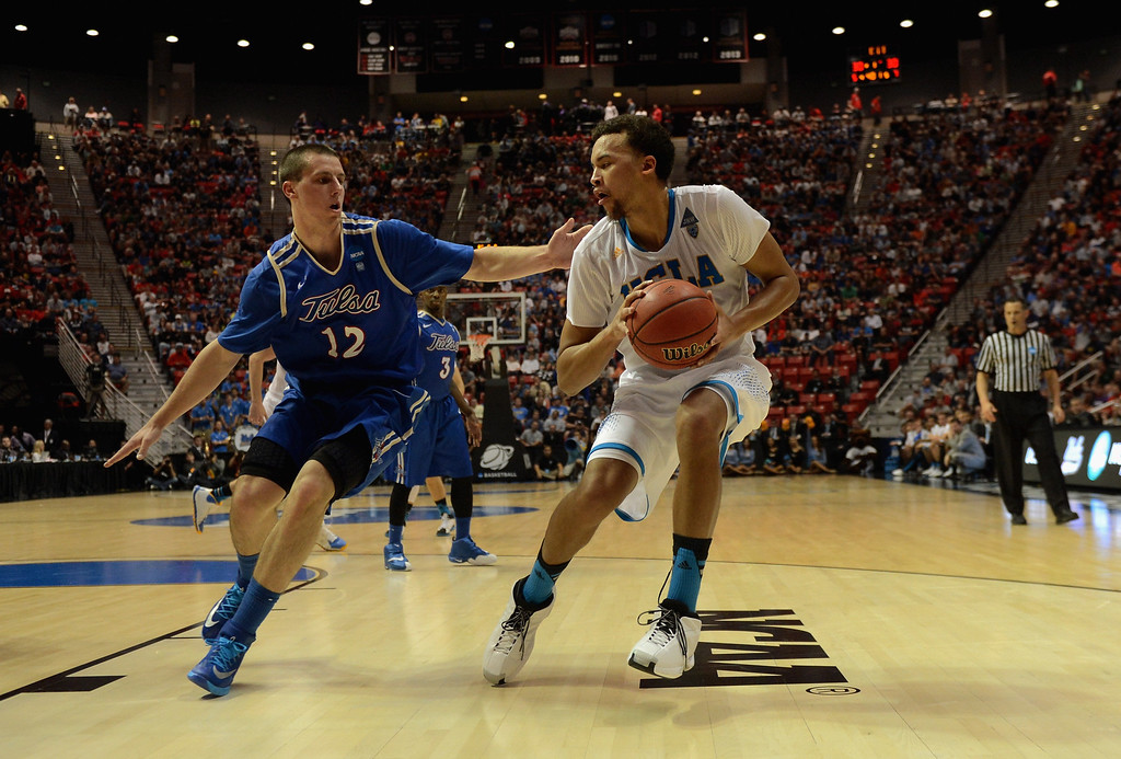 . Kyle Anderson #5 of the UCLA Bruins is guarded by Lew Evans #12 of the Tulsa Golden Hurricane during the second round of the 2014 NCAA Men\'s Basketball Tournament at Viejas Arena on March 21, 2014 in San Diego, California.  (Photo by Donald Miralle/Getty Images)
