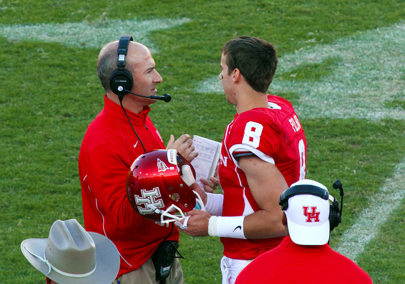 Coach Levine talks things over with quarterback Piland
