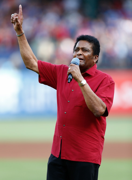 . Country music star Charley Pride sings the National Anthem before a baseball game between the Cleveland Indians and the Texas Rangers, Saturday, July 21, 2018, in Arlington, Texas. (AP Photo/Jim Cowsert)