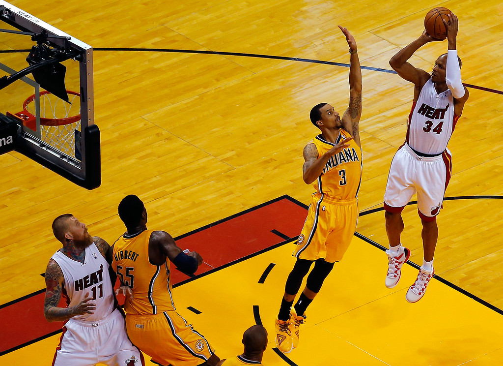 . MIAMI, FL - MAY 30: Ray Allen #34 of the Miami Heat takes a shot over George Hill #3 of the Indiana Pacers during Game Six of the Eastern Conference Finals of the 2014 NBA Playoffs at American Airlines Arena on May 30, 2014 in Miami, Florida.  (Photo by Chris Trotman/Getty Images)