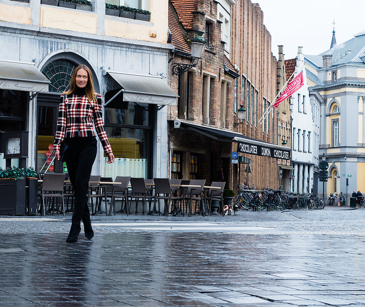 model walking in the wet streets bruges copy.jpg