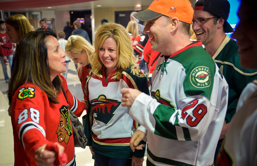 """. \""""There\'s no food for you here!\"""" joked Sandy Ruffner, left, of Chicago as she pretended to block the Grailer family from Ramsey prior to the start of Game 5. Tom (orange hat) and Traci Grailer decided at 11:30 PM last night to buy tickets for themselves and their three grown children as a Mother\'s Day present ($180 per ticket). \""""It\'s nice to all be together but the last 2 hours in the car were tough,\"""" said Traci with a smile. Her three kids are Max (21 with black hat), Reese, 16 (right) and Molly (23, not pictured), all of Ramsey. (Pioneer Press: Ben Garvin)"""