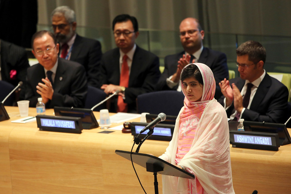 """. In this file photo dated Friday, July 12, 2013, United Nations Secretary-General Ban Ki-moon, left, applauds as Malala Yousafzai addresses the \""""Malala Day\"""" Youth Assembly, at United Nations headquarters. Malala Yousafzai, the Pakistani teenager shot by the Taliban for promoting education for girls, celebrated her 16th birthday on Friday addressing the United Nations. The U.N. has declared July 12 \""""Malala Day,\"""" to honor the teen who returned to school in March after medical treatment in Britain for injuries suffered in the October attack. Teenage activist Malala Yousafzai has jointly won the Nobel Peace Prize for her \""""heroic struggle\"""" for girls\' rights to education, it is announced Friday Oct. 10, 2014.  (AP Photo/Mary Altaffer)"""