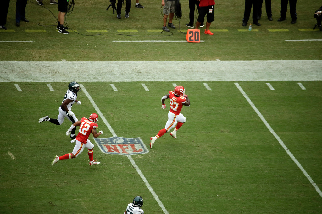 . Kansas City Chiefs running back Kareem Hunt (27) runs 53 yards for a touchdown in front of wide receiver Albert Wilson (12) and Philadelphia Eagles cornerback Rasul Douglas (32) during the second half of an NFL football game in Kansas City, Mo., Sunday, Sept. 17, 2017. (AP Photo/Charlie Riedel)
