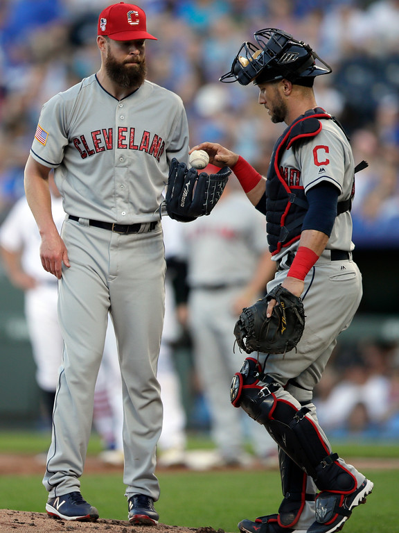 . Cleveland Indians starting pitcher Corey Kluber, left, takes the ball from catcher Yan Gomes, right, after giving up two runs in the first inning of a baseball game against the Kansas City Royals at Kauffman Stadium in Kansas City, Mo., Monday, July 2, 2018. (AP Photo/Orlin Wagner)