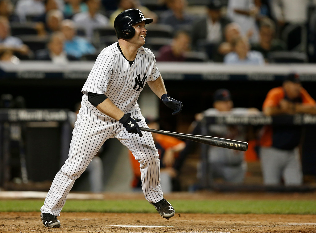 . New York Yankees Brian McCann watches his seventh-inning, solo home run off Detroit Tigers starting pitcher Justin Verlander in a baseball game at Yankee Stadium in New York, Wednesday, Aug. 6, 2014.  (AP Photo/Kathy Willens)