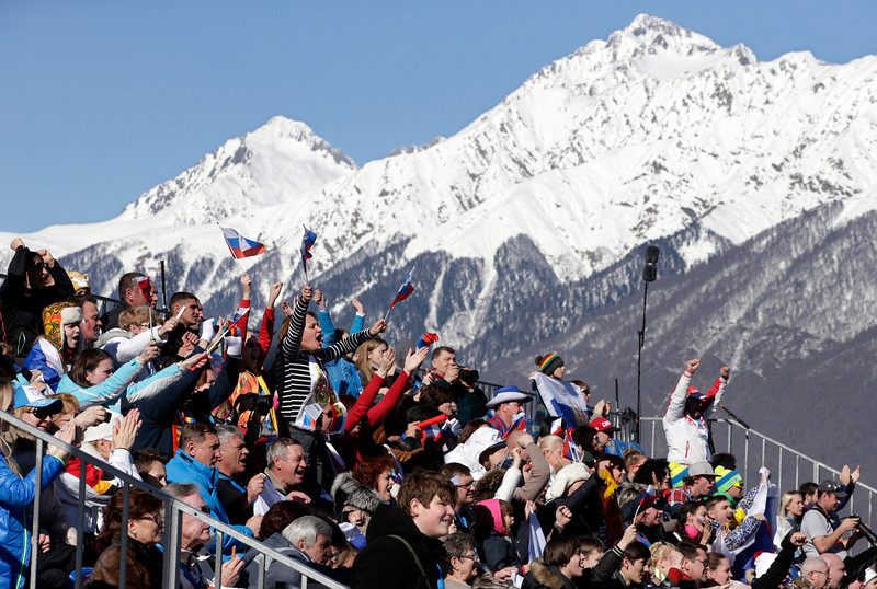 . Fans cheer from the stands during the women\'s skeleton competition at the 2014 Winter Olympics, Thursday, Feb. 13, 2014, in Krasnaya Polyana, Russia. (AP Photo/Michael Sohn)