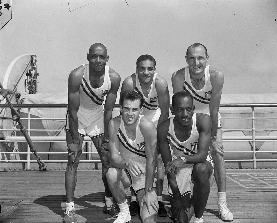 ". The U.S. 400-meter relay team pose on board the ocean liner ""America\"" enroute to England for the Summer Olympic games July 22, 1948.  Front row, left to right: Mel Patton, Los Angeles, Ca.; Harrison Dillard, Cleveland, Ohio. Rear, left to right: H. Norwood \""Barney\"" Ewell, Lancaster, Pa.; Edward Conwell, Jersey City, N.J. and Clifford Bourland, Los Angeles, Ca.  (AP Photo)"