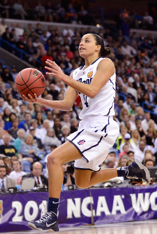 . NEW ORLEANS, LA - APRIL 09: Bria Hartley #14 of the Connecticut Huskies drives with the ball against the Louisville Cardinals in the second half during the 2013 NCAA Women\'s Final Four Championship at New Orleans Arena on April 9, 2013 in New Orleans, Louisiana.  (Photo by Stacy Revere/Getty Images)