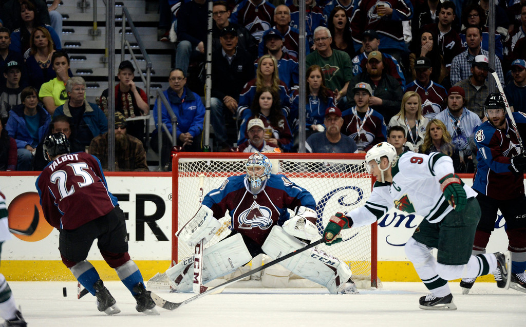 . DENVER, CO - APRIL 26: Colorado Avalanche goalie Semyon Varlamov (1) keeps an eye on the puck in his zone while Colorado Avalanche center Maxime Talbot (25) tries to clear during the first period of action. The Colorado Avalanche hosted the Minnesota Wild in the fifth round of the Stanley Cup Playoffs at the Pepsi Center in Denver, Colorado on Saturday, April 26, 2014. (Photo by John Leyba/The Denver Post)