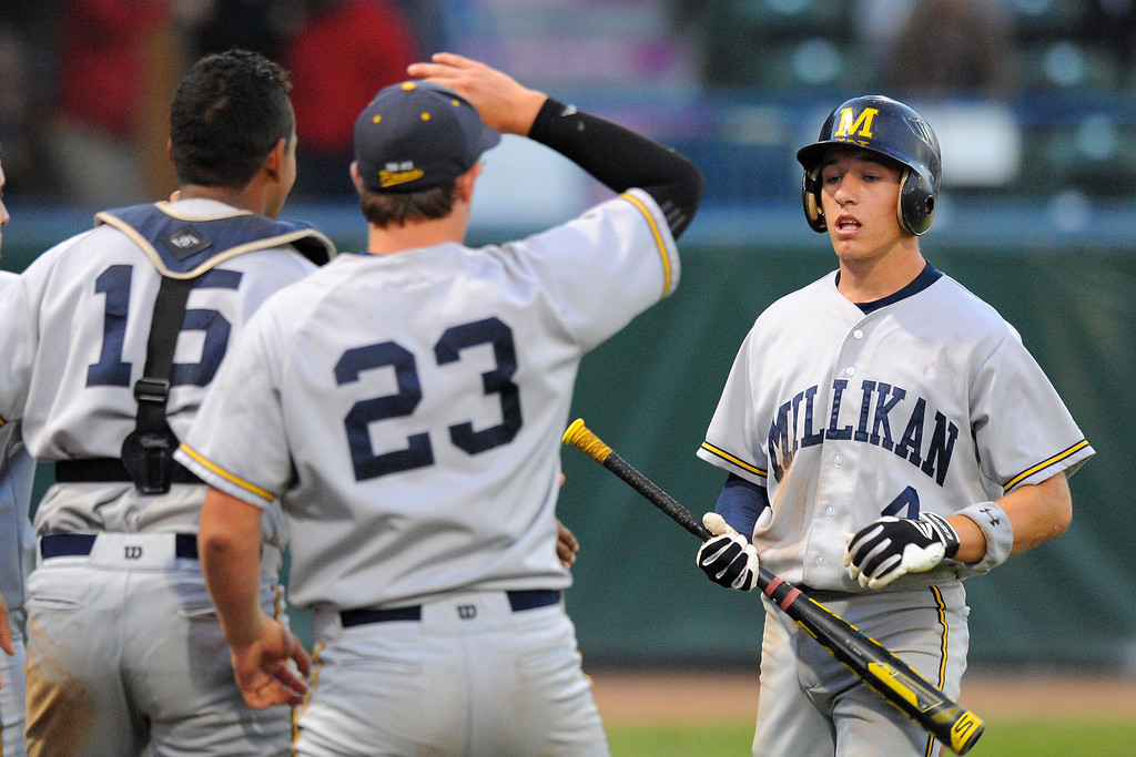 . LONG BEACH - 05/01/13 - (Photo: Scott Varley, Los Angeles Newspaper Group)  Lakewood vs Millikan baseball at Blair Field. Millikan\'s Johnny Weeks is welcomed back to the dugout aftet scoring in the 5th.