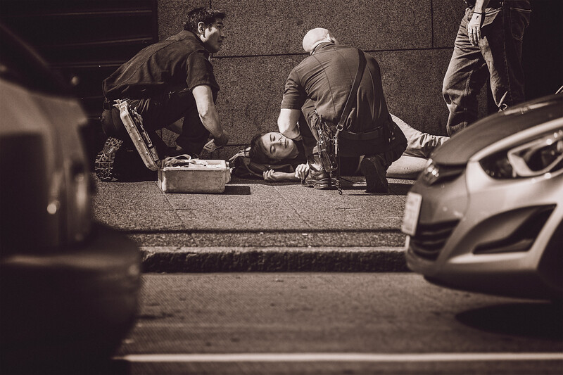 A young woman with a head injury is tended to buy medical personnel in downtown Seattle. I was unable to determine what happened.
