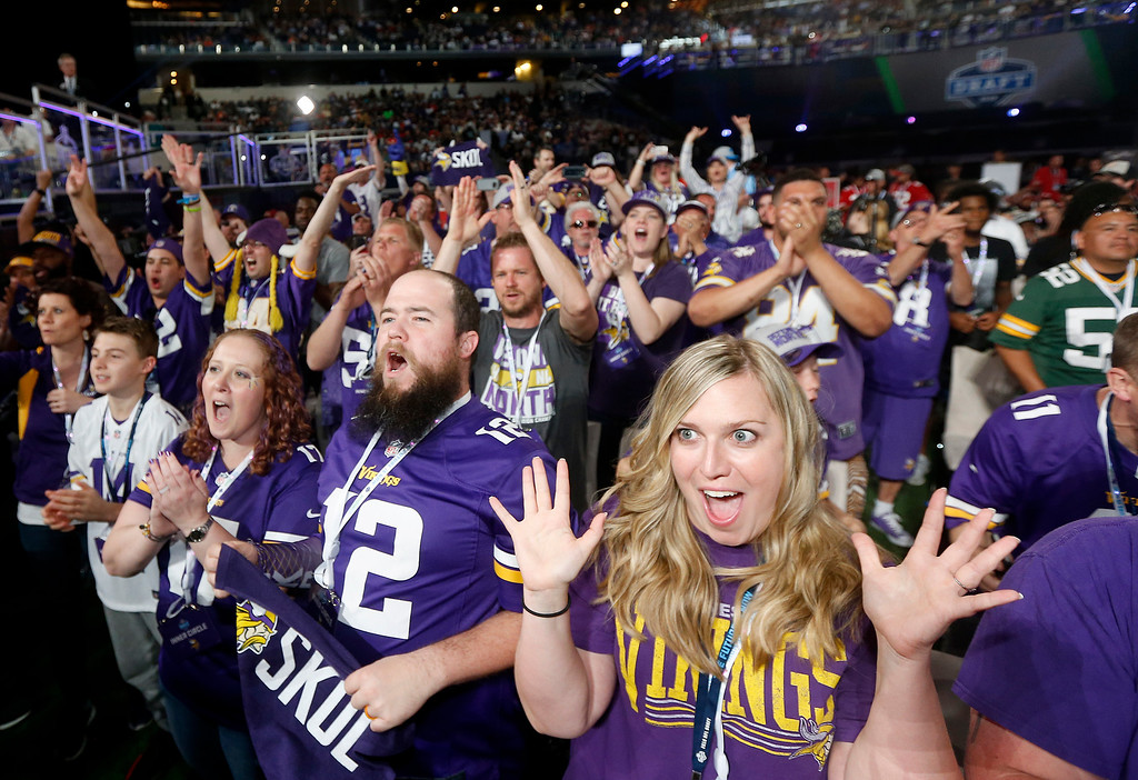 . Minnesota Vikings fans cheer during the first round of the NFL football draft, Thursday, April 26, 2018, in Arlington, Texas. (AP Photo/Michael Ainsworth)