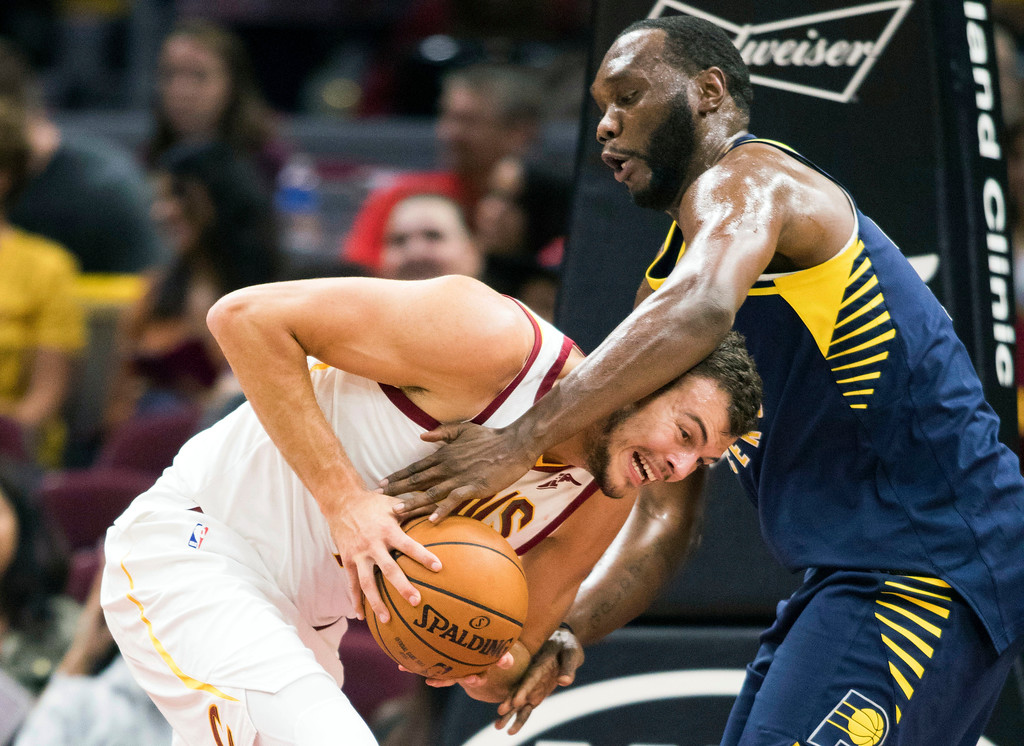 . Cleveland Cavaliers\' Ante Zizic, left, battles with Indiana Pacers\' Al Jefferson during the fourth quarter of an NBA preseason basketball game, Friday, Oct. 6, 2017, in Cleveland. The Pacers won 106-102. (AP Photo/Scott R. Galvin)