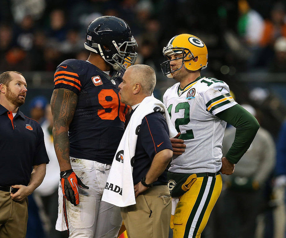 . Aaron Rodgers #12 of the Green Bay Packers talks with Julius Peppers #90 of the Chicago Bears after Peppers was flagged for roughing Rodgers at Soldier Field on December 16, 2012 in Chicago, Illinois. The Packers defeated the Bears 21-13.  (Photo by Jonathan Daniel/Getty Images)