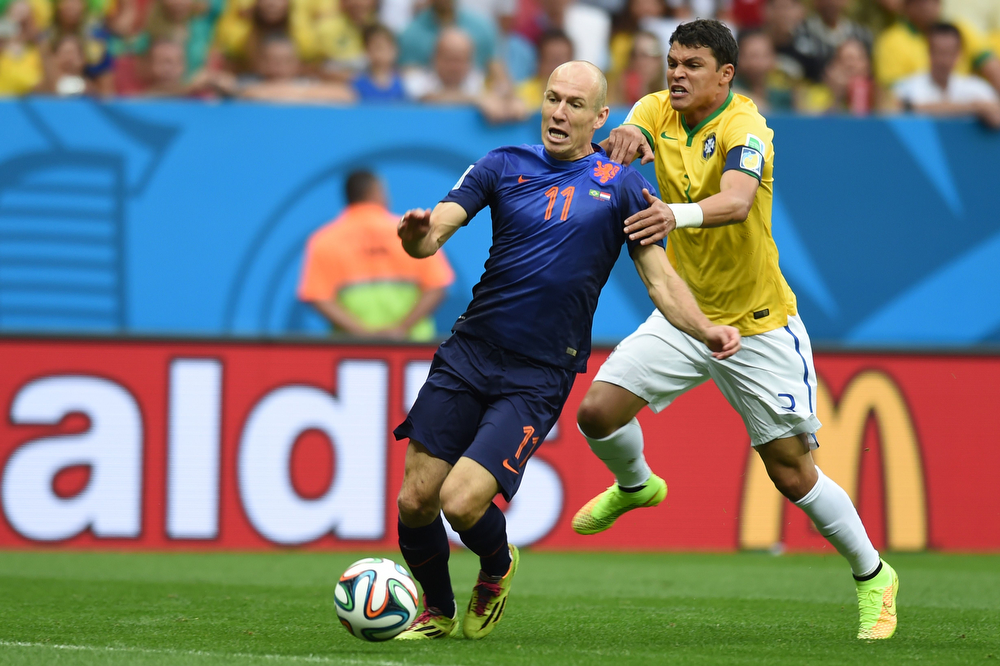 . Netherlands\' forward Arjen Robben (L) is fouled by Brazil\'s defender and captain Thiago Silva in the penalty area during the third place play-off football match between Brazil and Netherlands during the 2014 FIFA World Cup at the National Stadium in Brasilia on July 12, 2014. (VANDERLEI ALMEIDA/AFP/Getty Images)