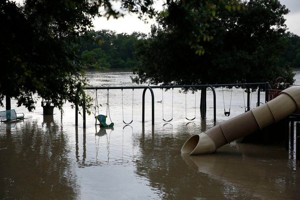 . A submerged playground sits in flood water at Bob Woodruff Park after heavy overnight rain in Plano, Texa,  Friday, May 29, 2015. Floodwaters submerged Texas highways and threatened more homes Friday after another round of heavy rain added to the damage inflicted by storms. (Andy Jacobsohn/The Dallas Morning News via AP)