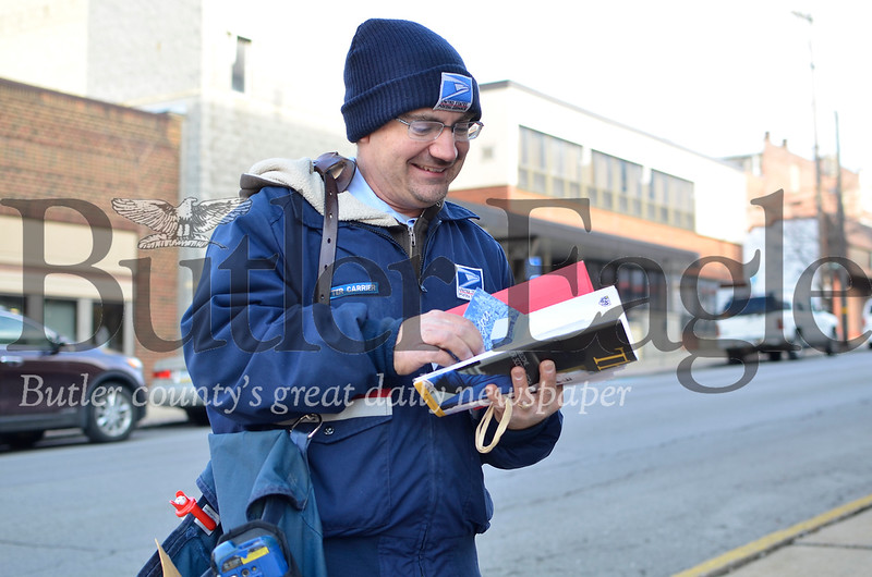 Paul Burkovich, a city mail carrier in Butler, delivers mail to businesses along W. Cunningham Street on Dec. 26, 2018. Tanner Cole/Butler Eagle