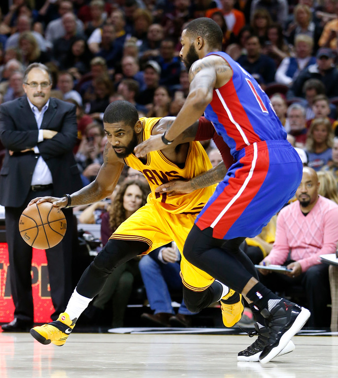 . Cleveland Cavaliers\' Kyrie Irving (2) drives past Detroit Pistons\' Marcus Morris during the second half of an NBA basketball game Friday, Nov. 18, 2016, in Cleveland. The Cavaliers won 104-81. (AP Photo/Ron Schwane)