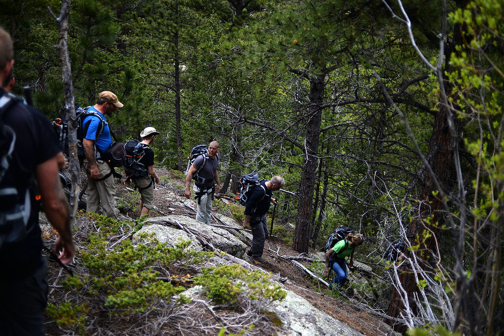 . WARD, CO - JUNE 10: Students work their way down a mountain on foot. Bear Grylls survival school at Glacier View Ranch near Ward, Colorado on Tuesday, June 10, 2014. (Photo by AAron Ontiveroz/The Denver Post)