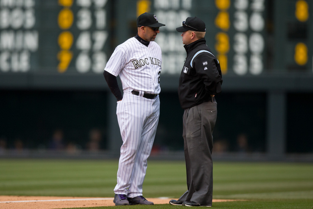 . DENVER, CO - APRIL 6:  Manager Walt Weiss of the Colorado Rockies asks first base umpire Mike Muchlinski to use his video replay challenge on a play at first base in the first inning during a game against the Arizona Diamondbacks at Coors Field on April 6, 2014 in Denver, Colorado.  Muchlinski called Charlie Blackmon #19 of the Colorado Rockies out at first on the field but the call was reversed after the review. (Photo by Justin Edmonds/Getty Images)
