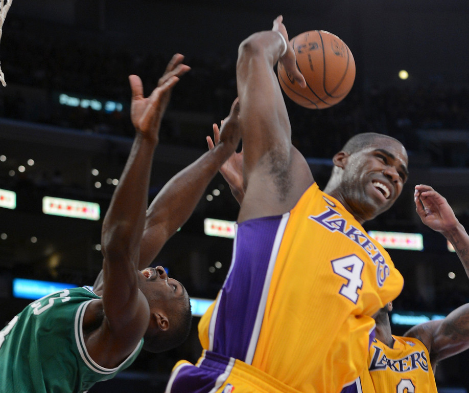 . Lakers Antawn Jamison and Celtics\' Jeff Green go for a rebound during second half action at Staples Wednesday. Lakers defeated the Celtics 113-99.  Photo by David Crane/Staff Photographer