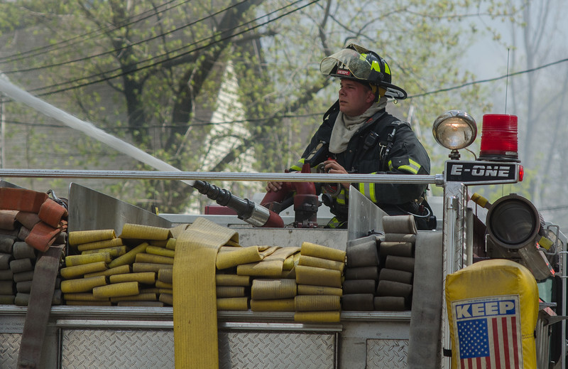 A Gardner FF plays a deck gun into a fully involved vacant factory on Sherman St at the outset of a 6 Alm fire.