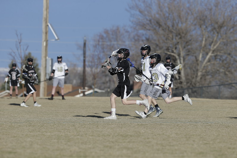 JPM0132-JPM0132-Jonathan first HS lacrosse game March 9th.jpg