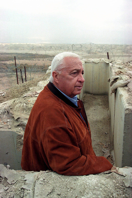 . A photograph dated from January 2001 shows former Israeli Prime Minister Ariel Sharon as he tours the Golan Heights and stands in a trench on the hilltops.   EPA/PAVEL WOLBERG