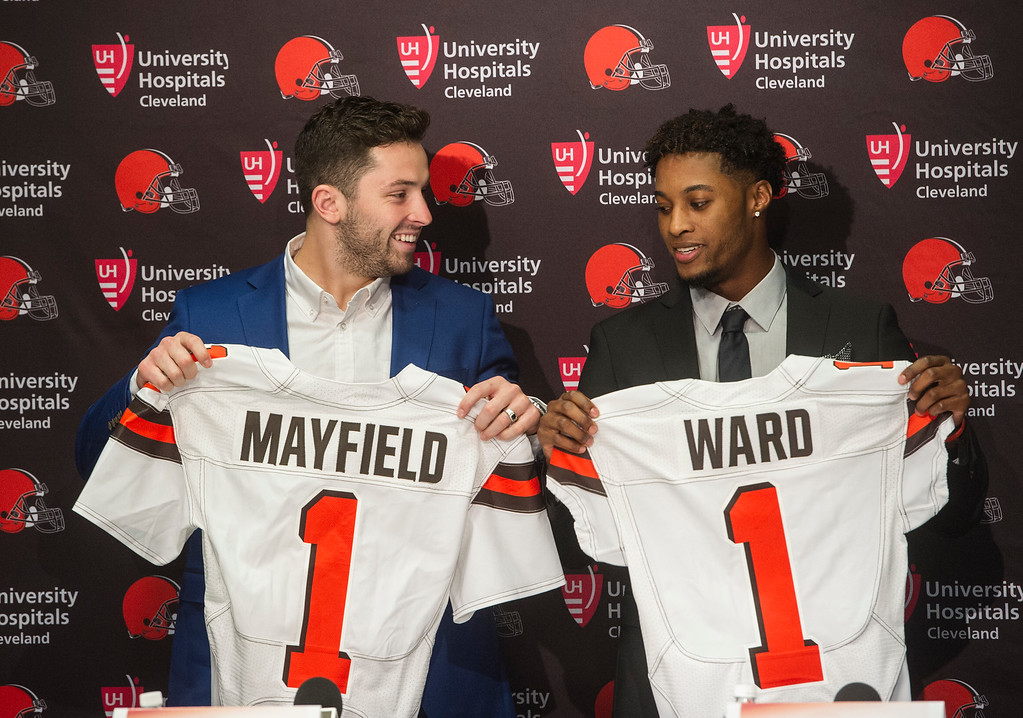. Cleveland Browns first-round draftees Baker Mayfield, left, and Denzel Ward pose after a news conference at the team\'s headquarters in Berea, Ohio, Friday, April 27, 2018. (AP Photo/Phil Long)