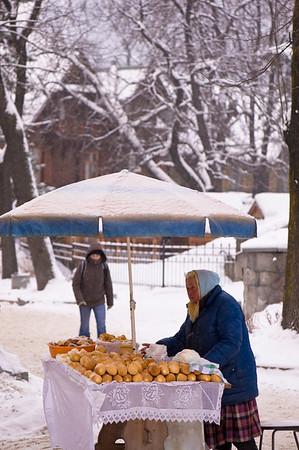 Woman selling smoked goat cheese, oscypki, on Krupowki Street,  Zakopane, Tatra Mountains, Podhale Region, Poland
