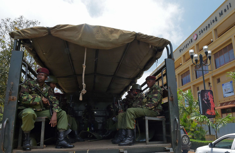 . Armed police look out during a memorial ceremony to mark one year since the Westgate terrorist attack, outside the Westgate mall in Nairobi on September 21, 2014. At least 67 people were killed and scores wounded when a small group of Al-Qaeda affiliated fighters stormed the Westgate mall on September 21, 2013. CARL DE SOUZA/AFP/Getty Images