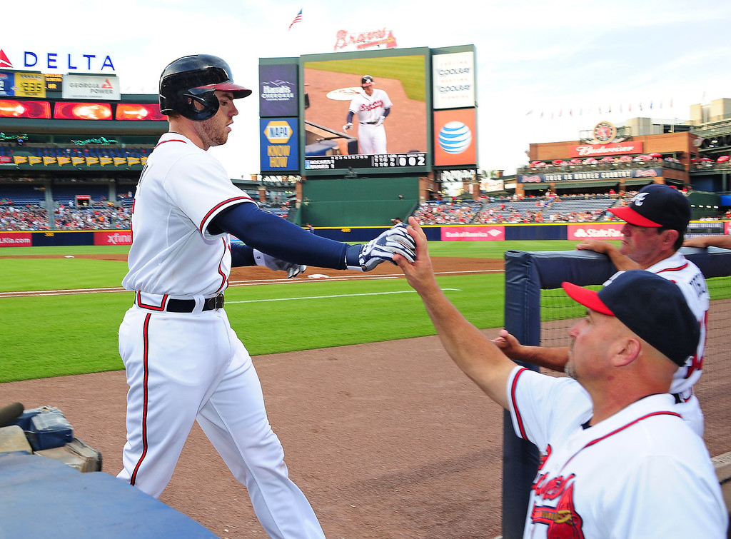 . Freddie Freeman #5 of the Atlanta Braves is congratulated by Manager Fredi Gonzalez #33 after hitting a first inning home run against the Colorado Rockies at Turner Field on July 30, 2013 in Atlanta, Georgia. (Photo by Scott Cunningham/Getty Images)