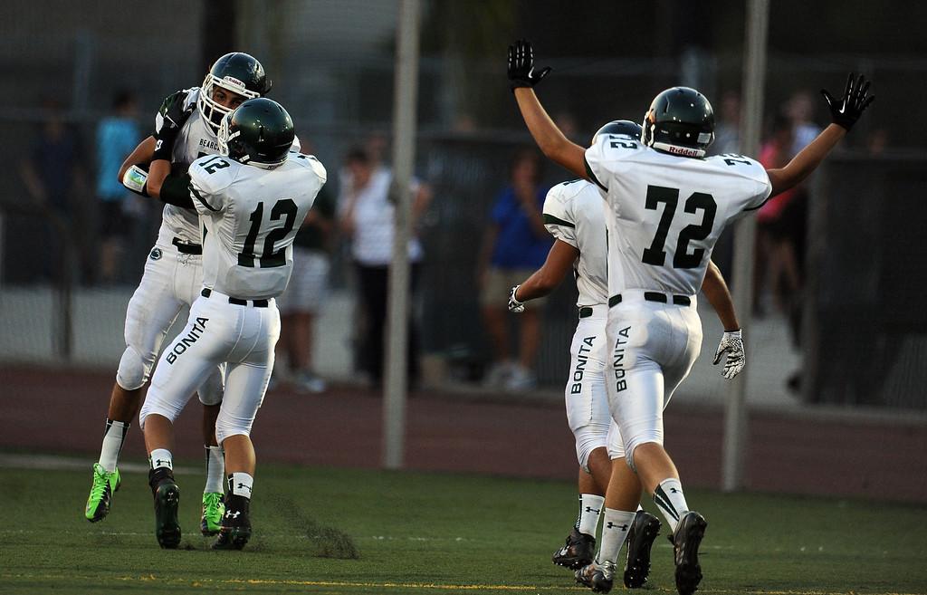 . Bonita\'s Jacob Karim (C) recovers a San Dimas fumble and runs for a touchdown in the first half of a prep football game at Citrus College on Thursday, Aug. 29, 2013 in Glendora, Calif.   (Keith Birmingham/Pasadena Star-News)