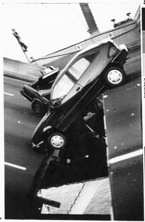 . Two vehicles hang on a dislodged section of the San Francisco-Oakland Bay Bridge  in Calif. on October 17, 1989 after the Loma Prieta earthquake. (Contra Costa Times/Tom Messner)
