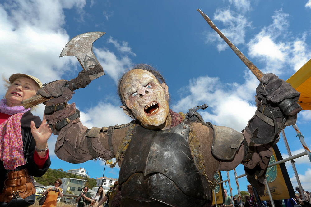 Description of . An orc poses after being made up for a prosthetic demonstration during the Hobbit Artisan Market ahead of the