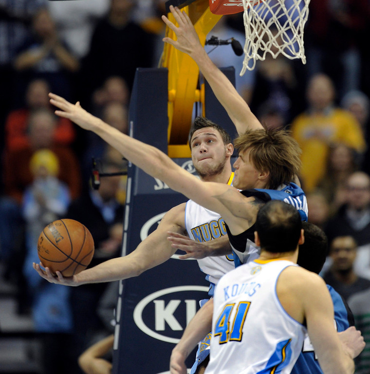 . Denver forward Danilo Gallinari (8) worked under the basket against Minnesota forward Andrei Kirilenko (47) in the first half. The Denver Nuggets hosted the Minnesota Timberwolves at the Pepsi Center Thursday night, January 3, 2013. Karl Gehring/The Denver Post