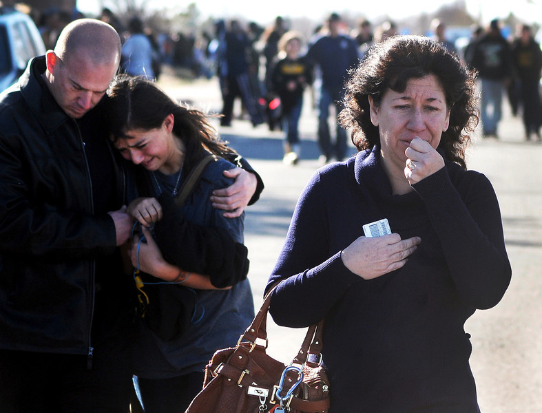 . A woman waits at a staging ground area where families are being reunited with Berrendo Middle School students after a shooting at the school, Tuesday, Jan. 14, 2014, in Roswell, N.M. A shooter opened fire at the middle school, injuring at least two students before being taken into custody. Roswell police said the school was placed on lockdown, and the suspected shooter was arrested. (AP Photo/Roswell Daily Record, Mark Wilson)