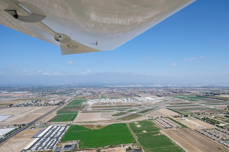Left downwind 26L at AOPA Regional Fly-in Chino, CA - 21SEP2014