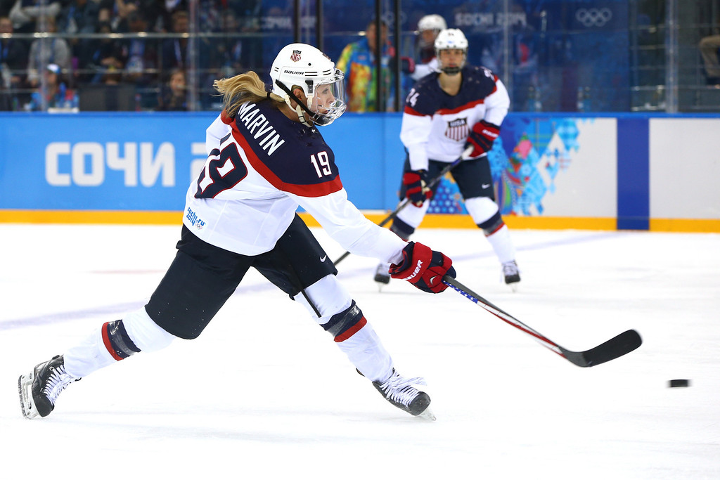 . Gigi Marvin #19 of the United States shoots against Canada in the second period during the Women\'s Ice Hockey Preliminary Round Group A game on day five of the Sochi 2014 Winter Olympics at Shayba Arena on February 12, 2014 in Sochi, Russia.  (Photo by Paul Gilham/Getty Images)