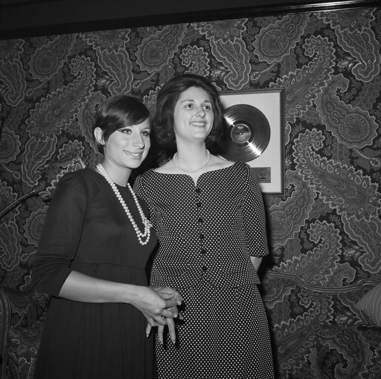 ". Lynda Bird Johnson, daughter of the President Lyndon Johnson, poses with Barbra  Streisand, at left, pose  backstage at the Winter Garden in New York June 8, 1965.    Miss Johnson attended a performance of ""Funny Girl\""  in which Miss Streisand stars. (AP Photo/ Marty Lederhandler)"