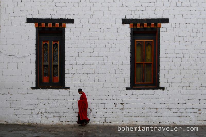 monk Tashichho Dzong in Thimphu Bhutan.jpg