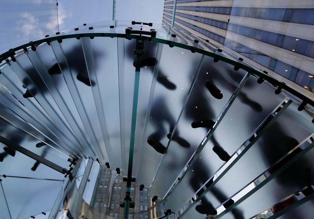 . Visitors to the Apple store descend a staircase to the showroom below to purchase the iPhone 6 and 6 Plus, Friday, Sept. 19, 2014,  in New York. The highly anticipated iPhone 6 and iPhone 6 Plus are being released in stores today. (AP Photo/Julie Jacobson)