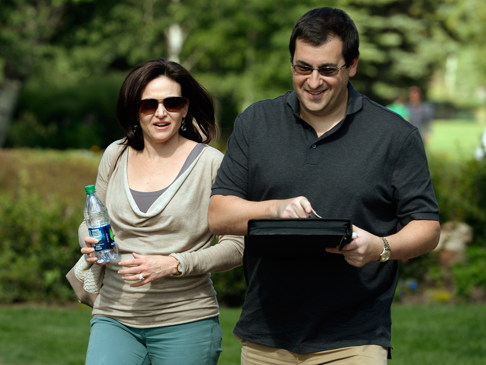 . Sheryl Sandberg, COO of Facebook, and her husband David Goldberg arrives for the Allen & Co. annual conference on July 9, 2013 in Sun Valley, Idaho. The resort will host corporate leaders for the 31th annual Allen & Co. media and technology conference where some of the wealthiest and most powerful executives in media, finance, politics and tech gather for weeklong meetings which begins Tuesday. Past attendees included Warren Buffett, Bill Gates and Mark Zuckerberg.  (Photo by Kevork Djansezian/Getty Images)