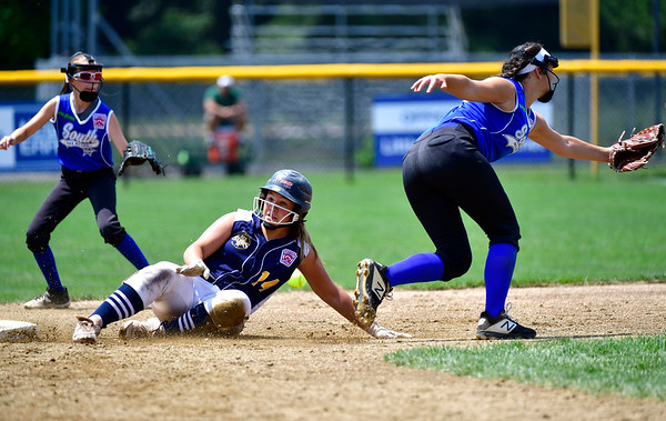 7/25/2019 Mike Orazzi | Staff Connecticut's Mya Dawid (14) and Pennsylvania's Sage Lorson (14) during the Eastern Regional Softball Tournament at Breen Field in