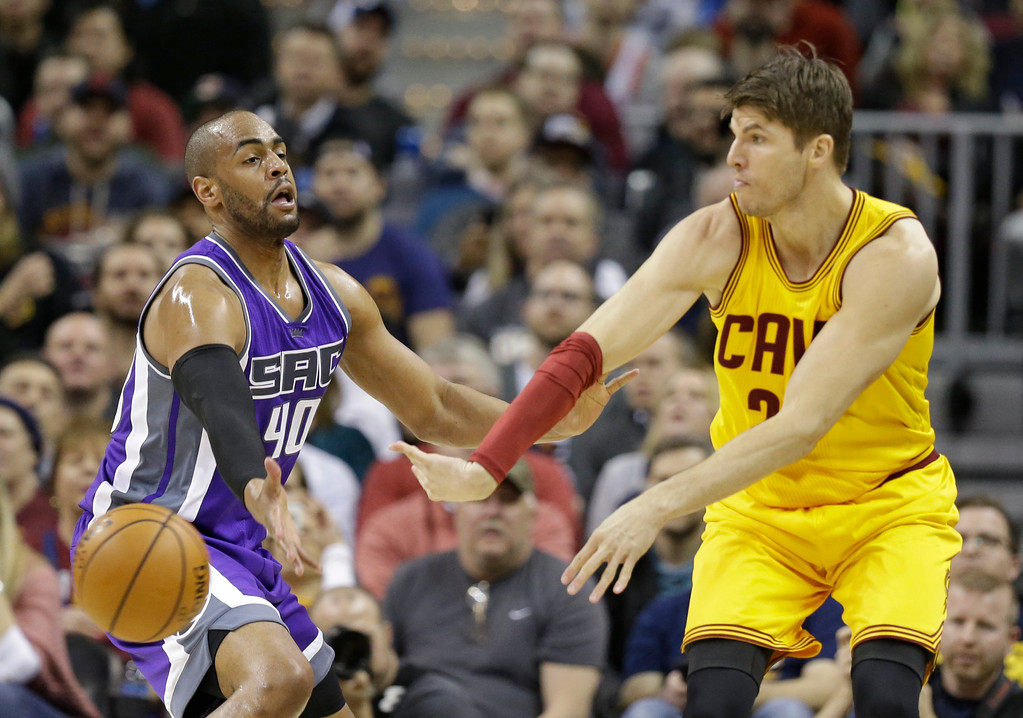 . Cleveland Cavaliers\' Kyle Korver, right, passes against Sacramento Kings\' Arron Afflalo during the first half of an NBA basketball game, Wednesday, Jan. 25, 2017, in Cleveland. (AP Photo/Tony Dejak)
