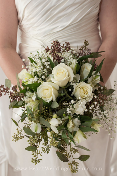 white mixture, greenery and seeded eucalyptus. Hand-tied